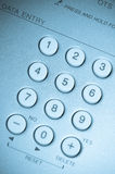 Close up view of white buttons blue toned Royalty Free Stock Image