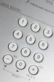 Close up view of white buttons on silver Royalty Free Stock Photography