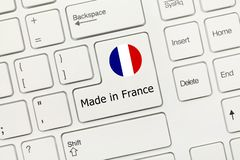 White conceptual keyboard - Made in France key with flag royalty free stock photos