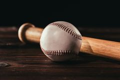 close-up view of white leather baseball ball and bat royalty free stock photos