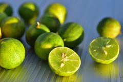 Fresh key lime fruit cut in half royalty free stock image