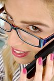 Close up view of woman busy on phone Royalty Free Stock Images