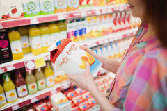 Close up view of woman buying fruits juice Stock Photography