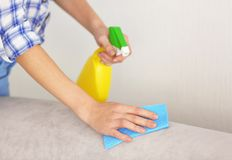 Close up view of woman cleaning sofa Royalty Free Stock Photos