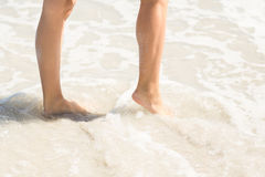 Close up view of woman foot on water Royalty Free Stock Photography
