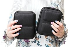 Close up view of woman hands holding two black cases for drone stock images