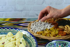 Close-up view, woman hands taking some oriental sweets, Samarkand, Uzbekistan. Close-up view, woman hands taking some oriental sweets Royalty Free Stock Photo