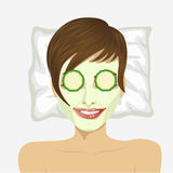 Close-up view of woman having anti-aging and revitalising facial treatment with cucumbers Royalty Free Stock Image