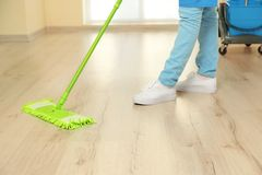 Close up view of woman moping floor. At home Stock Photos