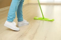 Close up view of woman moping floor. At home Royalty Free Stock Image