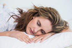 Close up view on woman sleeping in cosy bed Stock Photography