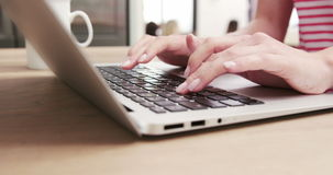 Close up view of a woman typing on her laptop stock video footage