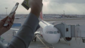 Close up view of woman using mobile terminal on smartphone to make online payment by credit card near airport window. Close up view of woman using mobile stock video