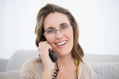 Close up view of woman wearing glasses talking on the telephone Stock Images