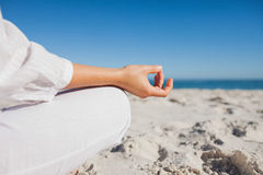 Close up view of womans hand in yoga pose. At beach Stock Image