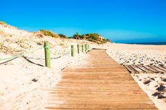 Close up view of a wood board walk in the beach Stock Photos