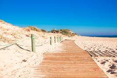 Close-up view of a wood board walk in the beach Royalty Free Stock Photo