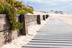 Close-up view of a wood board walk in the beach Stock Photography