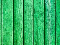 Close-up view of a green wooden background. Yellow vintage wooden fence background Royalty Free Stock Photo