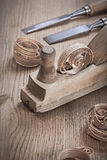 Close up view on woodworkers planner and chissels Stock Images