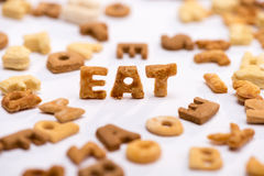 Close-up view of word eat and healthy breakfast cereal alphabet Royalty Free Stock Photo