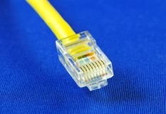 Close-up view of the yellow Ethernet (RJ45) cable Stock Image