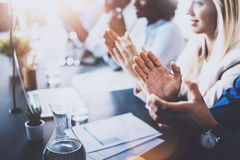 Close up view of young business partners applauding to reporter after listening report at seminar. Professional. Education, work meeting, presentation or Stock Image