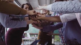 Close-up view of young business team puts palm together Two mans fist greeting each other. slow mo stock footage