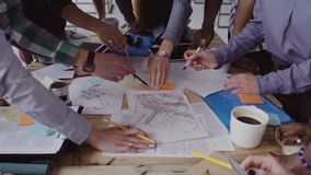 Close-up view of young business team working together near the table, brainstorming. stock video footage