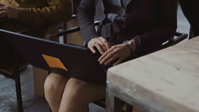 Close-up view of young businesswoman typing at laptop. Female student sitting on the chair at seminar at lecture hall. stock video footage
