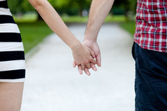Close up view of a young couple holding hands Royalty Free Stock Image