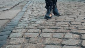 Close-up view of young female walking through the downtown. Businesswoman wearing black shoes with heels. tourist woman stock footage