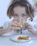 Close-up view of Young girl drinking cup of tea Stock Image