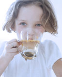 Close-up view of Young girl drinking cup of tea Royalty Free Stock Photos