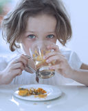 Close-up view of Young girl drinking cup of tea Royalty Free Stock Photo