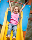 Close-up view of young girl on slide in playground Royalty Free Stock Photos