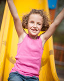 Close-up view of young girl on slide in playground Stock Photography