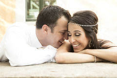 Close up view of young happy bridal couple laughing together Royalty Free Stock Images