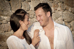 Close up view of young happy couple laughing together stock image