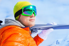 Close-up view of young man wearing mask in winter. Close-up view of young man wearing ski mask holds ski with beautiful mountain view on Sochi ski resort Stock Photography