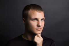 Close-up view of young thinking man Royalty Free Stock Photography