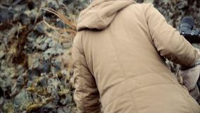 Close-up view of young traveling woman with camera hiking in mountains. Attractive girl exploring the nature landmarks. Close-up view of young traveling woman stock video