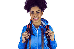Close up view of a young woman with camera and backpack Stock Images