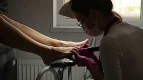 Close Up View Of Young Woman Getting Professional Pedicure In Luxury Beauty Salon. Master Is Sawing Old Color From Nails stock footage