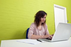 Close-up view of Young woman working at her desk Royalty Free Stock Image