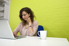 Close-up view of Young woman working at her desk Stock Photo