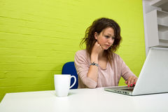 Close-up view of Young woman working at her desk Stock Images