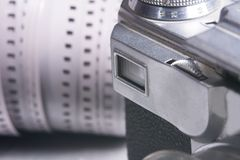 Close-up viewfinder of an old film camera. Camera on the background of a roll of negative film Royalty Free Stock Images