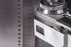 Close-up viewfinder of an old film camera. Camera on the background of a roll of negative film Stock Photography