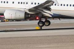 Commercial Airliner Landing On A Runway. Close up views of passenger jets touching down on a runway Stock Photography